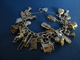 #0820 Silver Charm Bracelet - Music Themed - 24 Charms - circa 1965 **SOLD**