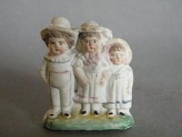 #1777 Small Victorian or Edwardian 'Biscuit' Porcelain Figure Group. circa 1890-1910