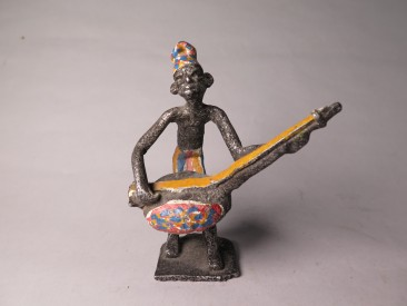#1509 Early or Mid 20th Century West African Cast Aluminium Figure of a Masquerade Musician, circa 1920 - 1960